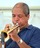 African american musician. Jazz trumpet player blowing his horn in concert on stage Royalty Free Stock Photos