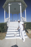 African-American in Natchez, MS paints Gazebo with new coat of white paint Stock Photo