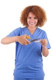 African American nurse cutting a cigarette with scissors  -  Bla. African American nurse cutting a cigarette with scissors, isolated on white background Stock Images
