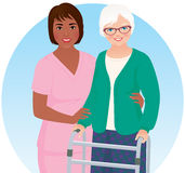 African American nurse and her patient. African American nurse helps her elderly patient Royalty Free Stock Image
