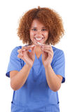 African American nurse holding a broken cigarette  -  Black peop Stock Photo