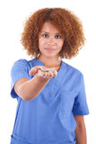 African American nurse holding a broken cigarette  -  Black peop. African American nurse holding a broken cigarette, isolated on white background  -  Black Stock Photos