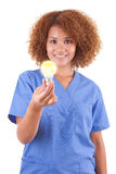 African American nurse holding a light bulb - Black people. African American nurse holding a light bulb, isolated on white background - Black people Stock Images