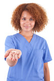 African American nurse holding pills needle - Black people. African American nurse holding pills, isolated on white background - Black people Stock Photography
