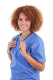 African American nurse holding a stethoscope  -  Black people. African American nurse holding a stethoscope, isolated on white background - Black people Stock Photo