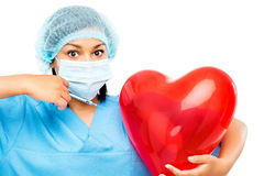 African american nurse holidng heart Royalty Free Stock Photo
