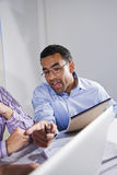 African American office worker in meeting Royalty Free Stock Photo