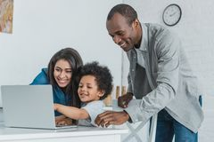 African american parents and son using laptop. At home royalty free stock photography
