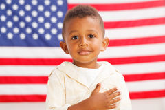 African-American patriotic boy. African-American little boy with American flag on a background Royalty Free Stock Photo