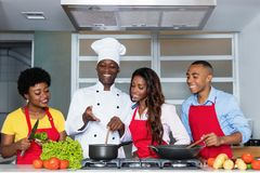 African american people learn cooking from chef stock photography