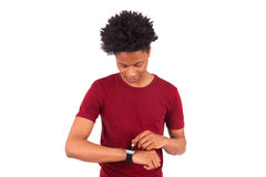 African American person wearing a smart watch, isolated on white Stock Photos