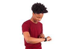 African American person wearing a smart watch, isolated on white Royalty Free Stock Images
