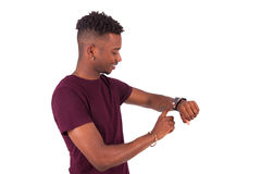 African American person wearing a smart watch, isolated on white Royalty Free Stock Photos