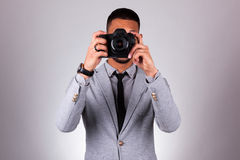 African american photographer holding a dslr camera - Black peop Stock Image