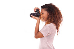 African American photographer taking pictures with a dslr camera Stock Images