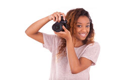 African American photographer taking pictures with a dslr camera Royalty Free Stock Photos