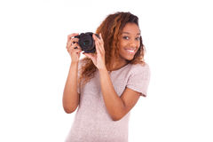African American photographer taking pictures with a dslr camera Stock Photos