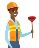 African-american plumber holding plunger. Cheerful african-american female plumber with toilet plunger. Young smiling plumber in hard hat holding a plunger Royalty Free Stock Images
