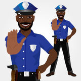 African american policeman showing stop gesture Stock Photos
