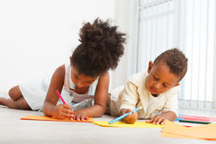 African american preschoolers. Drawing on the floor Royalty Free Stock Images