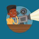African-american projectionist showing new film. Royalty Free Stock Photography