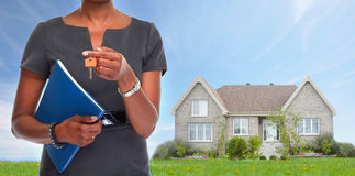 African-American realtor woman with key. Stock Photography