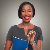 African-American realtor woman with key. Royalty Free Stock Photos