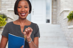 African-American realtor woman with key. Stock Images