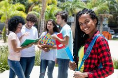 African american scholarship student with group of international. Students outdoor on campus of university royalty free stock image