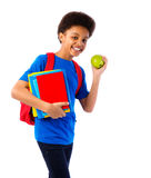 African American school boy with books. Happy African American school boy, teenager with colorful books, school bag and apple. Education and school concept Royalty Free Stock Photos