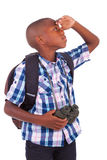 African American school boy holding binoculars - Black people Royalty Free Stock Image
