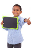 African American school boy holding a blank black board - Black Stock Photos