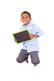 African American school boy holding a blank black board - Black Royalty Free Stock Photo
