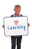 African American school boy holding a blank board - Black people Stock Photo
