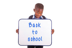 African American school boy holding a blank board - Black people Stock Images