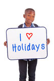 African American school boy holding a blank board - Black people Royalty Free Stock Photography
