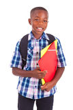 African American school boy, holding folders - Black people Stock Photography