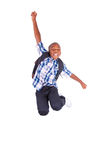 African American school boy jumping - Black people Stock Photo
