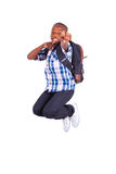 African American school boy jumping - Black people. African American school boy jumping , isolated on white background - Black people Stock Photo