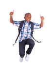 African American school boy jumping and making thumbs up - Black Stock Photography