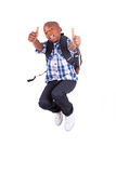 African American school boy jumping and making thumbs up - Black Stock Photos
