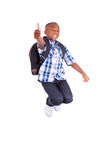 African American school boy jumping and making thumbs up - Black Royalty Free Stock Image