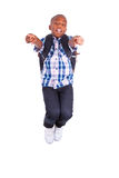 African American school boy jumping and making thumbs up - Black Stock Image