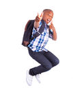 African American school boy jumping and making thumbs up - Black Royalty Free Stock Images