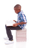 African American school boy reading a book - Black people. African American school boy reading a book, isolated on white background - Black people Stock Photography