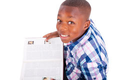African American school boy reading a book - Black people. African American school boy reading a book, isolated on white background - Black people Stock Photos
