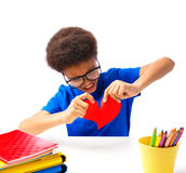 African American school boy tears apart valentines heart royalty free stock photo
