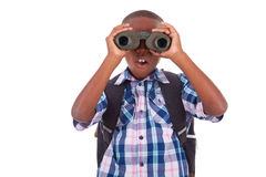 African American school boy using binoculars - Black people. African American school boy using binoculars, isolated on white background - Black people Royalty Free Stock Images