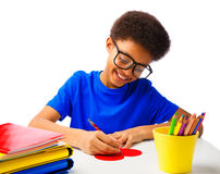 African American School Boy writing message at Valentines Heart Royalty Free Stock Image