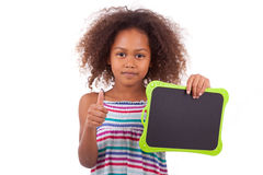 African American school girl holding a blank black board - Black Stock Photos